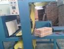 内蒙古乌市全自动发泡水泥防火板包装机,定做纸箱套膜包装机厂家